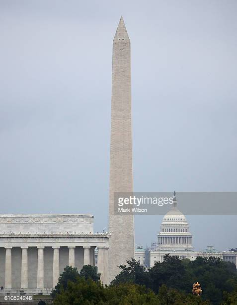 The Washington Monument is viewed between the Lincoln Memorial and US Capitol on September 26 2016 in Washington DC US Park National Park Service...