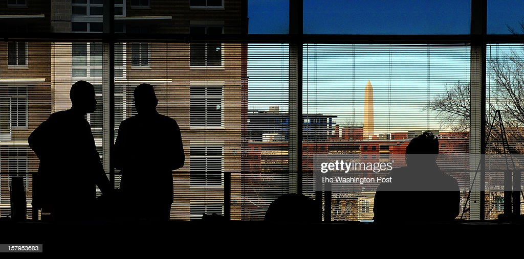 The Washington Monument is visible through a window where Veterans Services representatives wait for clients as the Washington Nationals and the U.S. Chamber of Commerce's National Chamber Foundation hold a job fair for the military on December, 05, 2012 in Washington, DC.