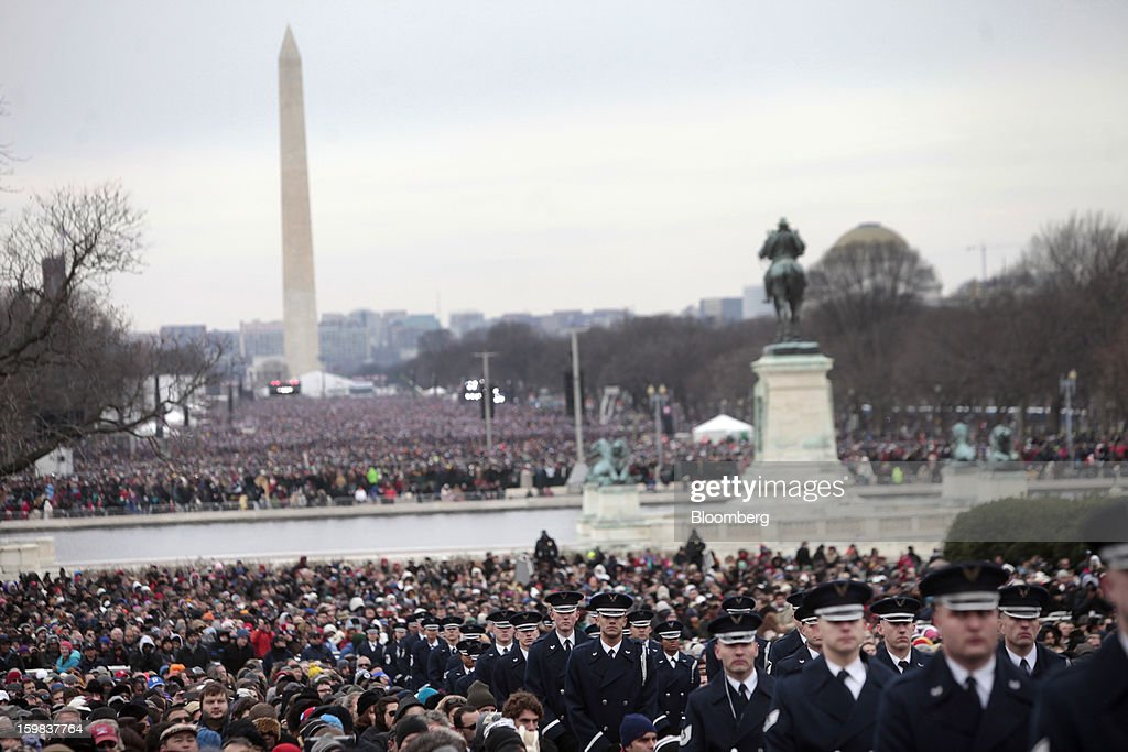The Washington monument stands as attendees and members of the U.S. Air Force gather during the U.S. presidential inauguration in Washington, D.C., U.S., on Monday, Jan. 21, 2013. As he enters his second term, President Barack Obama has shed the aura of a hopeful consensus builder determined to break partisan gridlock and adopted a more confrontational stance with Republicans. Photographer: Victor J. Blue/Bloomberg via Getty Images