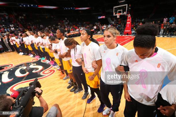 The Washington Mystics and the Los Angeles Sparks lock arms during the national anthem on August 16 2017 at the Verizon Center in Washington DC NOTE...