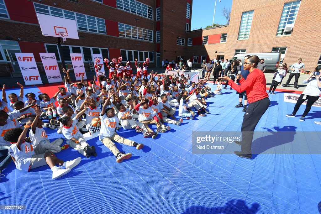 The Washington Mystics participates in a clinic at Hendley Elementary school during a court dedication and WNBA Fit Clinic on October 17, 2017 at Hendley Elementary school in Washington, DC.