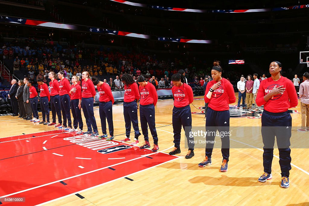 The Washington Mystics stand for the National Anthem before the game against the San Antonio Stars on June 29, 2016 at the Verizon Center in Washington, DC.