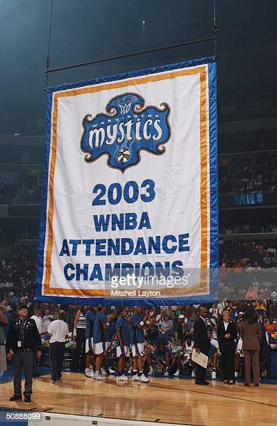 The Washington Mystics unvail the 2003 attendance banner before opening night against the Charlotte Sting May 22 2004 at the MCI Center in Washington...