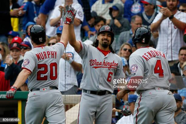 The Washington Nationals' Anthony Rendon greets teammates Daniel Murphy and Howie Kendrick after Murphy hit a tworun home run in the first inning...
