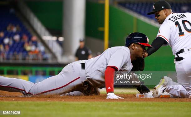The Washington Nationals' Michael Taylor steals the base as Miami Marlins third baseman Christian Colon is unable to tag him in time during the third...