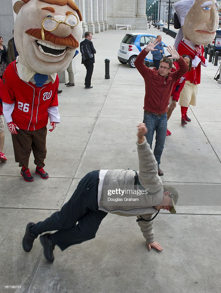 The Washington Nationals' presidential mascot's where on hand at Union Station for a dance off to win tickets to the baseball game. Here Steven Goldberg (gray sweater) puts on his best moves to win the ticket give away on April 22, 2013. Goldberg walked away with two free tickets.