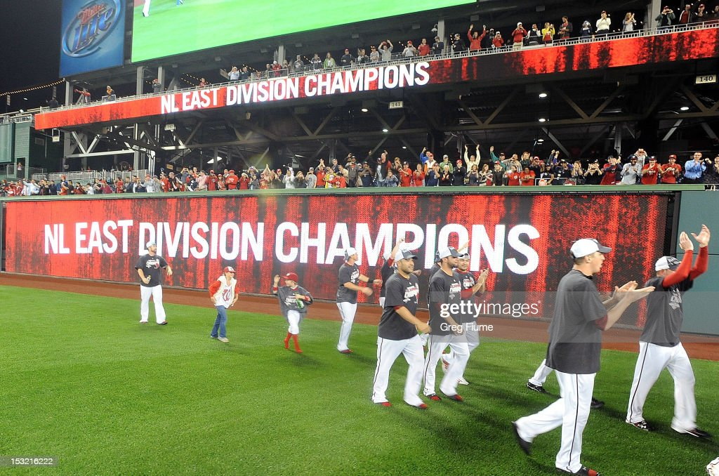 The Washington Nationals run around the field and celebrate after winning the National League East Division Championship after the game against the Philadelphia Phillies at Nationals Park on October 1, 2012 in Washington, DC.