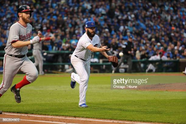 The Washington Nationals' Stephen Strasburg left runs down the first base line after a successful sacrifice bunt in the fourth inning as Chicago Cubs...