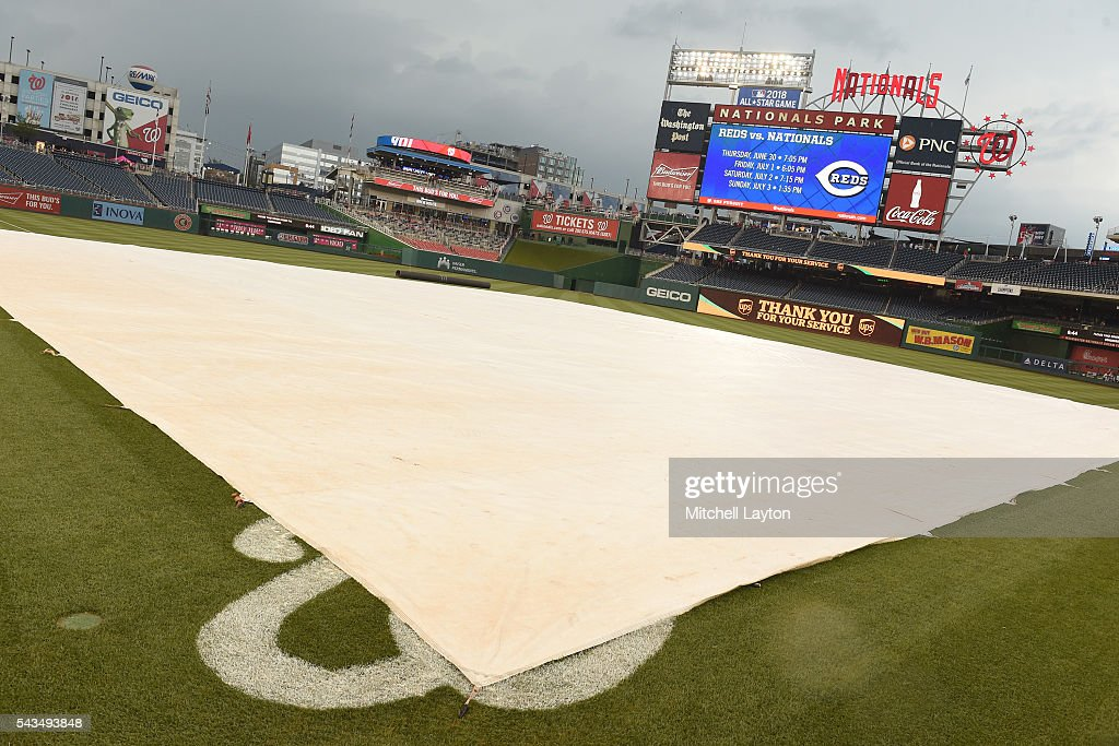 The Washington Nationals tarp is on field due to storms in the area before a baseball game against the New York Mets at Nationals Park on June 28, 2016 in Washington, DC.