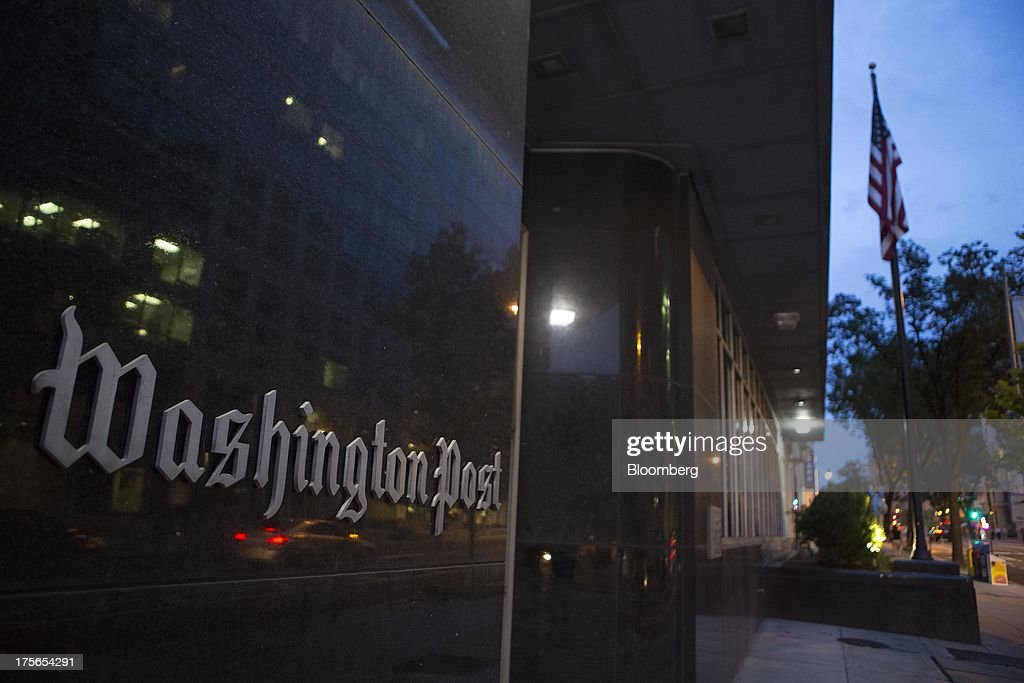 The Washington Post Co. headquarters stands in Washington, D.C., U.S., on Monday, Aug. 5, 2013. Amazon.com Inc. Chief Executive Officer Jeff Bezos agreed to buy the Washington Post for $250 million, betting that he can apply his success in e-commerce to the struggling newspaper industry. Photographer: Andrew Harrer/Bloomberg via Getty Images
