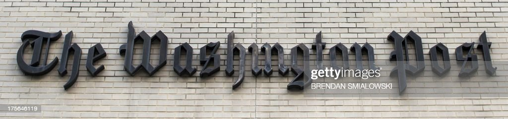 The Washington Post is seen on August 5, 2013 in Washington, DC, after it was announced that Amazon.com founder and CEO Jeff Bezos had agreed to purchase the Post for USD 250 million. Multi-billionaire Bezos, who created Amazon, which has soared in a few years to a dominant position in online retailing, said he was buying the Post in his personal capacity and hoped to shepherd it through the evolution away from traditional newsprint. AFP PHOTO/Brendan SMIALOWSKI