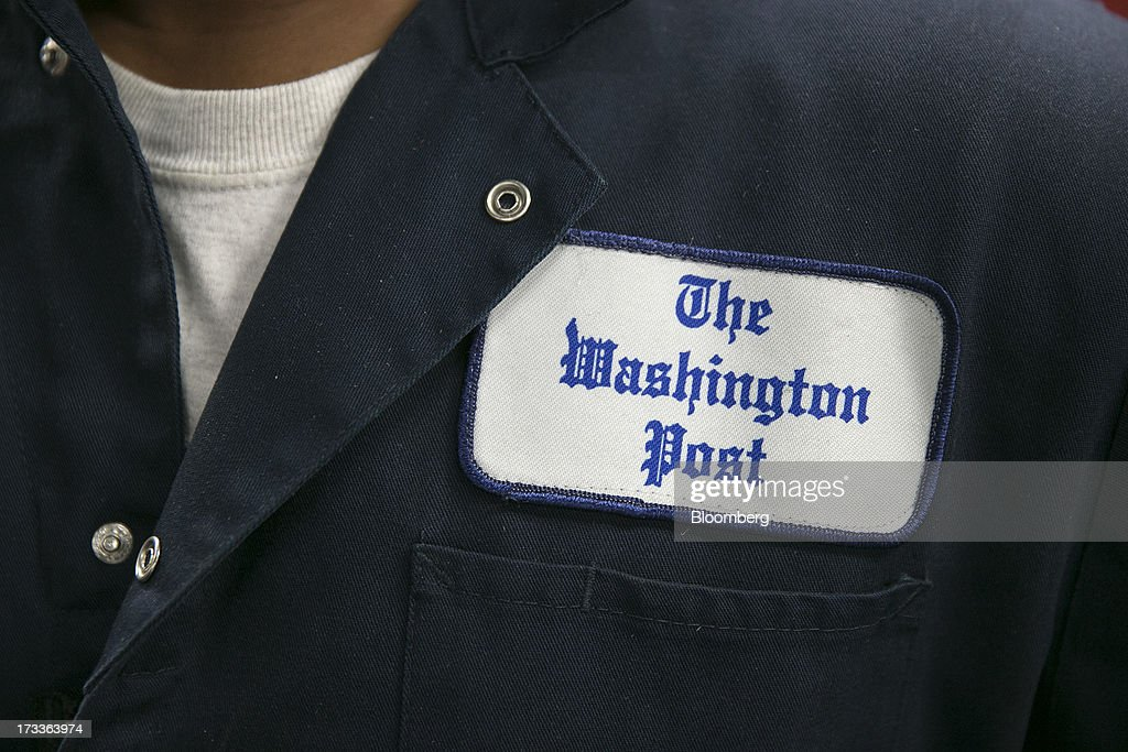 The Washington Post logo is seen on an employee's coveralls in this photo arranged at the Post's newspaper production facility in Springfield, Virginia, U.S., on Friday, July 12, 2013. The Washington Post began publishing on Thursday, Dec. 6, 1877, and had a circulation of 10,000. The newspaper contained four pages and cost three cents a copy. Photographer: Andrew Harrer/Bloomberg via Getty Images