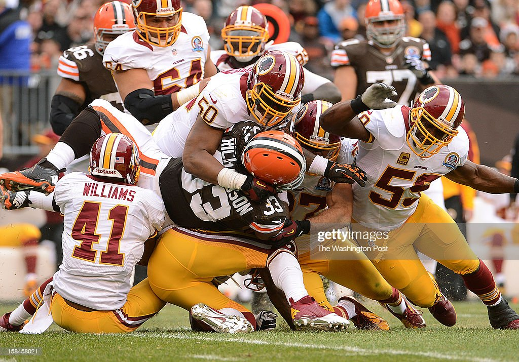 The Washington Redskins defense stop Cleveland Browns running back Trent Richardson (33) after a gain of only one yard in the first quarter during the game between the Washington Redskins and the Cleveland Browns at the Cleveland Browns Stadium on Sunday, December 16, 2012.