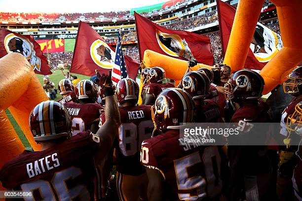 The Washington Redskins run onto the field prior to a game against the Pittsburgh Steelers at FedExField on September 12 2016 in Landover Maryland