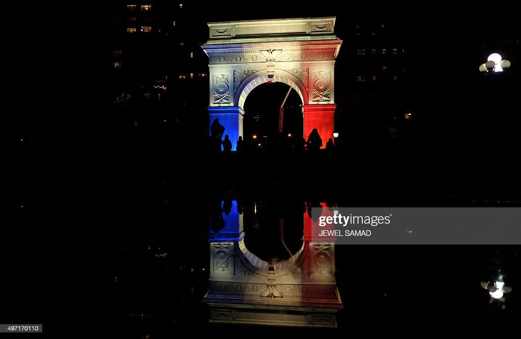 The Washington Square Park arch is lit with the French national colors in solidarity with the citizens of France on November 14 2015 in New York a...