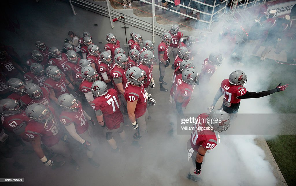 The Washington State Cougars football team prepares to take the field before the start of the Apple Cup game against the Washington Huskies at Martin Stadium on November 23, 2012 in Pullman, Washington.