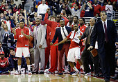 The Washington Wizards bench celebrates during the closing moments of their 105101 win over the Miami Heat at Verizon Center on December 4 2012 in...