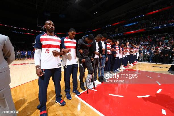 The Washington Wizards during the national anthem before the game against the Philadelphia 76ers on October 18 2017 at Capital One Arena in...