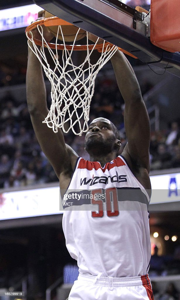 The Washington Wizards' Emeka Okafor (50) dunks against the Chicago Bulls in the second half at the Verizon Center in Washington, D.C., Tuesday, April 2, 2013. The Wizards won, 90-86.