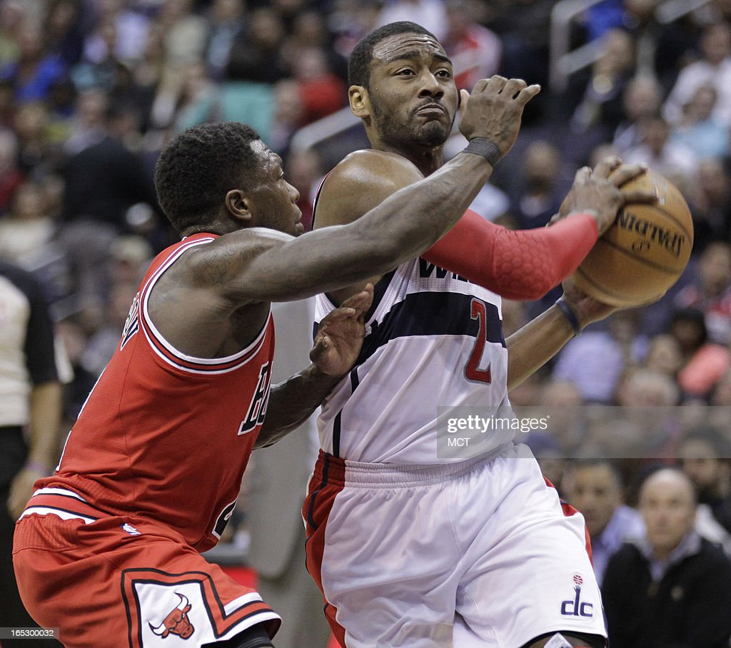 The Washington Wizards' John Wall (2) drives against the Chicago Bulls' Nate Robinson, left, in the second half at the Verizon Center in Washington, D.C., Tuesday, April 2, 2013. The Wizards won, 90-86.