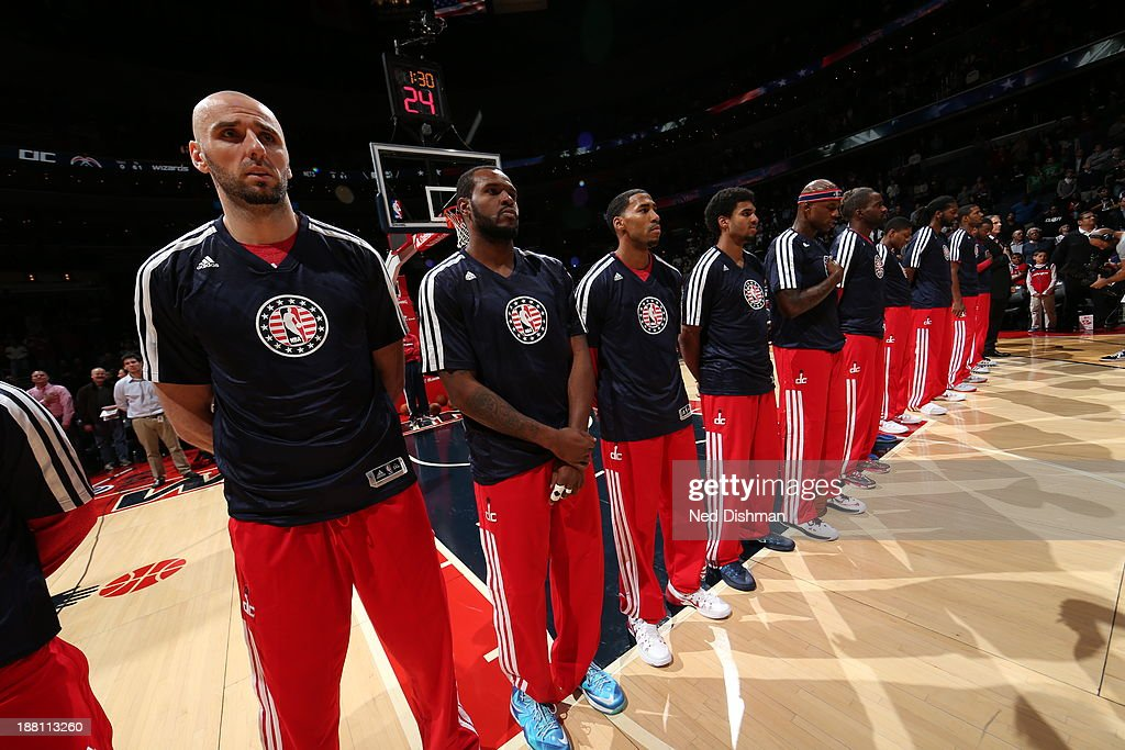 The Washington Wizards line up for the national anthem before the game against the Brooklyn Nets at the Verizon Center on November 8, 2013 in Washington, DC.