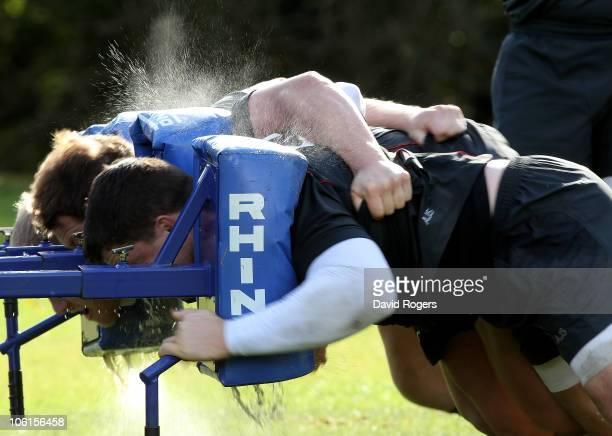 The water is squeezed out of the scrum machine pads as England practice their scrummaging technique during the England training session at Pennyhill...