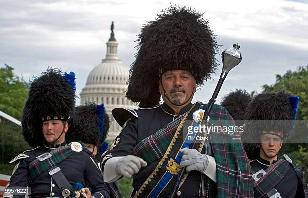 The Waterbury Connecticut Pipes and Drums Corps marches up New Jersey Avenue NW to F Street to get in place for the 12th Annual Emerald Society...