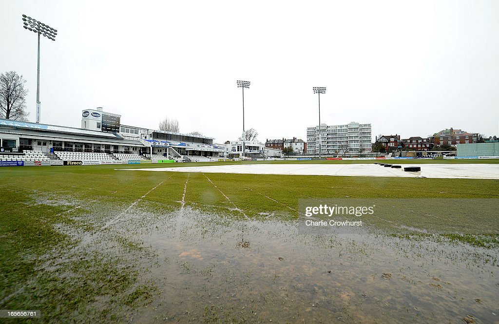 The waterlogged pitch holds up the start of play prior to the friendly match between Sussex and Loughborough MCCU at the Brighton and Hove Jobs County Ground on April 05, 2013 in Hove, England,