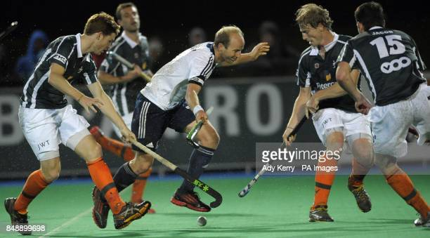 The Waterloo Ducks defence combine to foul east Grinstead's Glenn Kirkham during the EuroHockey League Round 12 game at East Grinstead HC West Sussex