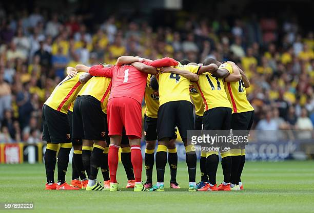 The Watford first eleven group huddle before kick off during the Premier League match between Watford and Arsenal at Vicarage Road on August 27 2016...