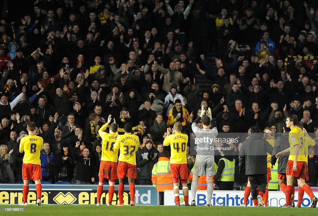 The Watford team acknowledges their fans during the npower Championship match between Brighton & Hove Albion and Watford at The Amex Stadium on December 29, 2012 in Brighton England.