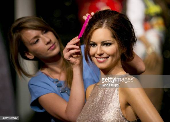 The wax figure of Cheryl FernandezVersini gets a make over at Madame Tussauds on July 29 2014 in London England