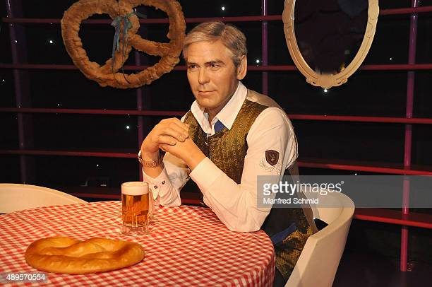 The wax figure of George Clooney in traditional Austrian dress on display during the Wiener Wiesn photocall at Madame Tussauds Vienna on September 22...
