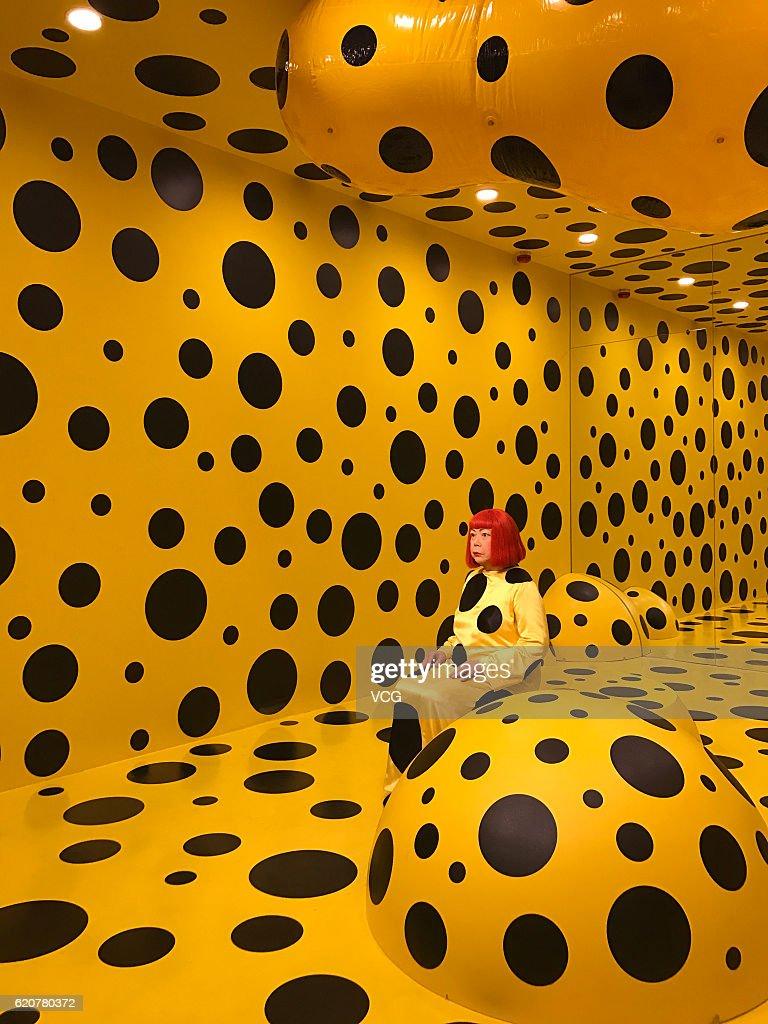 The wax figure of Japanese artist Yayoi Kusama is surrounded by the polka dots at Madame Tussauds Hong Kong on November 2, 2016 in Hong Kong, China.