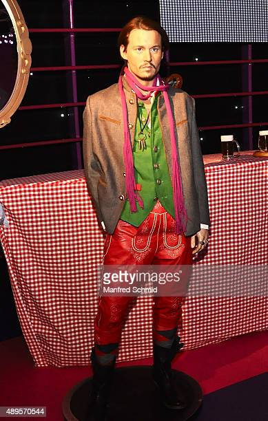 The wax figure of Johnny Depp in traditional Austrian Lederhosen on display during the Wiener Wiesn photocall at Madame Tussauds Vienna on September...