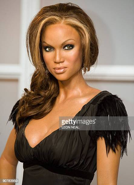 The wax figure of US model Tyra Banks is united with the new look figure of British model Kate Moss at Madame Tussauds in central London on September...