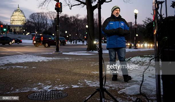 The Weather Channel's Jim Cantore broadcasts news about the impending blizzard in Washington in front of the US Capitol at sunrise on Thursday Jan 21...