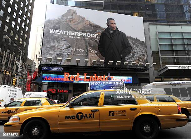 The Weatherproof Garment Company's billboard hangs in Times Square in New York on January 7 2010 featuring a photograph of US President Barack Obama...