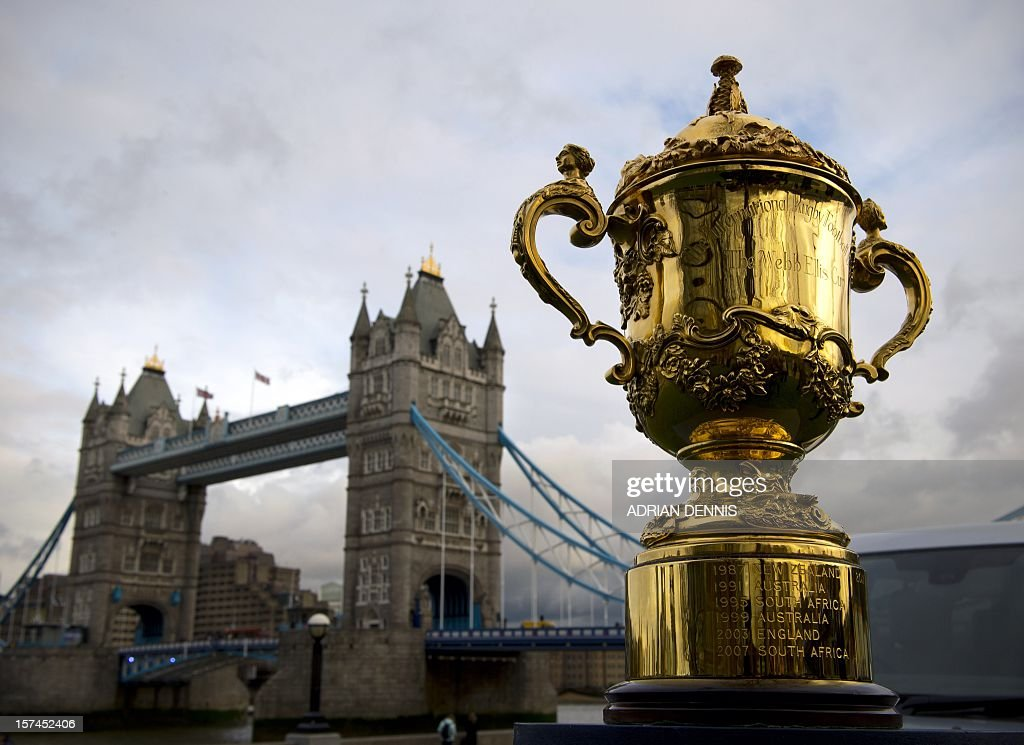 The Webb Ellis Cup, is displayed close to Tower Bridge ahead of the Rugby World Cup draw in London on December 3, 2012. Teams in the top three bands are to be drawn for the England 2015 tournament. There will be four pools of five teams to compete at the Rugby World Cup 2015. Band 1 consists of: New Zealand, South Africa, Australia and France. Band 2 consists of: England, Ireland, Samoa and Argentina. Band 3 consists of Wales, Italy, Tonga and Scotland. The final two positions in each pool will be allocated to the eight qualifying places which are still available.