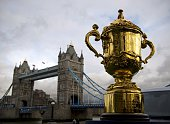 The Webb Ellis Cup is displayed close to Tower Bridge ahead of the Rugby World Cup draw in London on December 3 2012 Teams in the top three bands are...