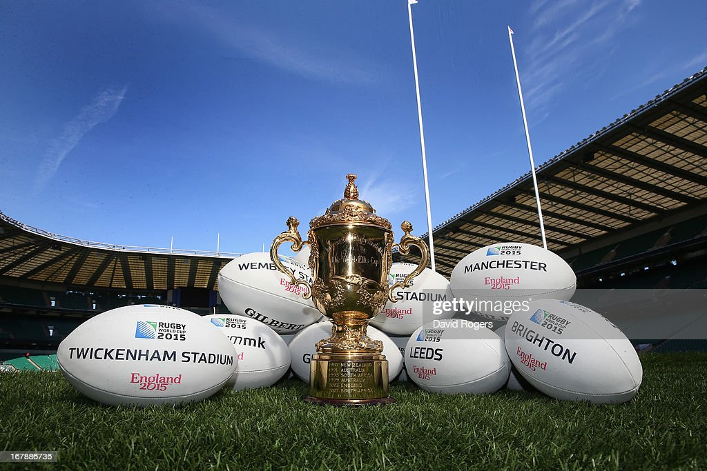 The Webb Ellis Cup sits on the pitch with rugby balls showing the venues during the IRB Rugby World Cup 2015 Schedule Annoucement held at Twickenham Stadium on May 2, 2013 in London, England. The 13 Match Venues and Host Cities selected are: Twickenham Stadium (London), Wembley Stadium (London), Olympic Stadium (London), Millennium Stadium (Cardiff), Manchester City Stadium (Manchester), St James' Park (Newcastle), Elland Road (Leeds), Leicester City Stadium (Leicester), Villa Park (Birmingham), Kingsholm Stadium (Gloucester), stadiummk (Milton Keynes), Brighton Community Stadium (Brighton) and Sandy Park (Exeter).
