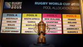 The Webb Ellis trophy is displayed during the media session following IRB Rugby World Cup 2015 pool allocation draw at the Blue Fin Building on...