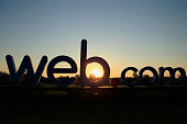 The Webcom sign is seen at sunrise prior to the start of the second round of the United Leasing Championship held at Victoria National Golf Club on...