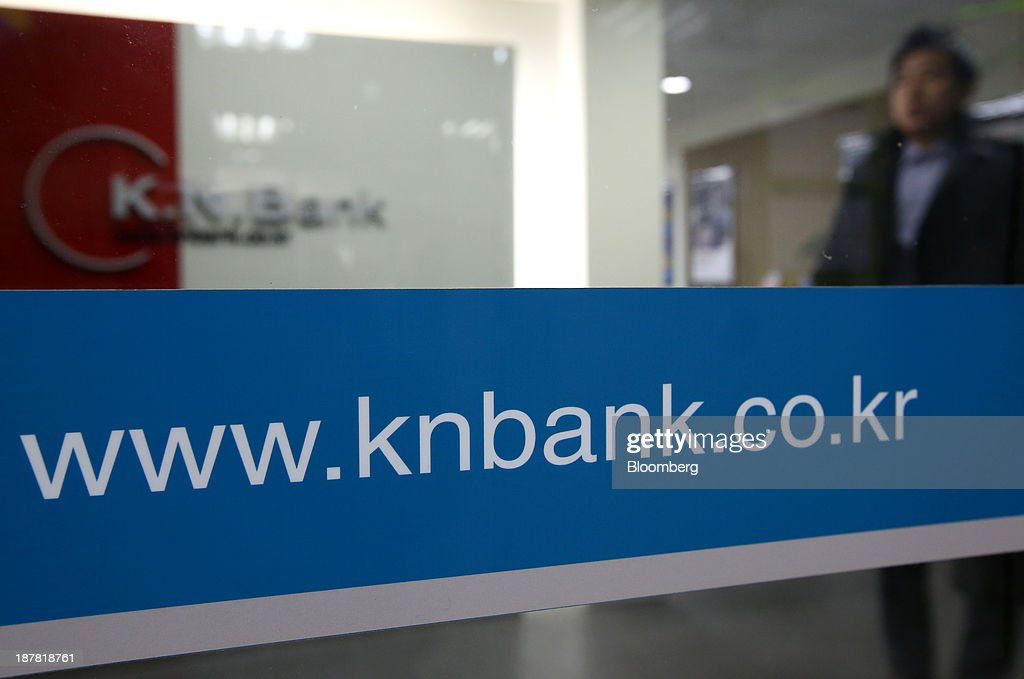 The website address for Kyongnam Bank, a unit of Woori Finance Holdings Co., is displayed at one of the bank's branches in Seoul, South Korea, on Tuesday, Nov. 12, 2013. Woori Finance Holdings is scheduled to report third-quarter results on Nov. 14. Photographer: SeongJoon Cho/Bloomberg via Getty Images