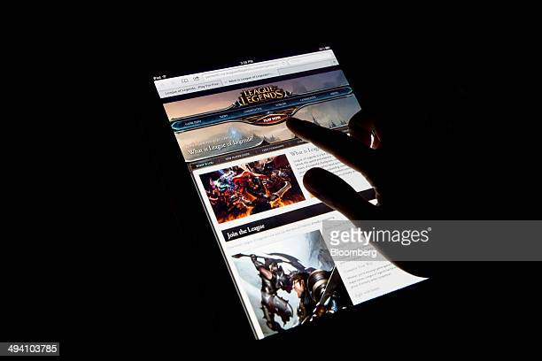 The website for League of Legends a game developed by Riot Games Inc a subsidiary of Tencent Holdings Ltd is displayed on an Apple Inc iPad in an...