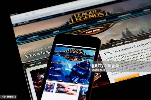 The website for League of Legends a game developed by Riot Games Inc a subsidiary of Tencent Holdings Ltd is displayed on an Apple Inc iPad bottom...