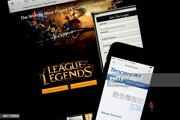 The website for League of Legends a game developed by Riot Games Inc a subsidiary of Tencent Holdings Ltd is displayed on an Apple Inc iPad below an...