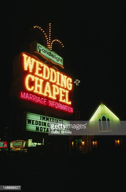 The Wedding Chapel and neon signs illuminated at night.