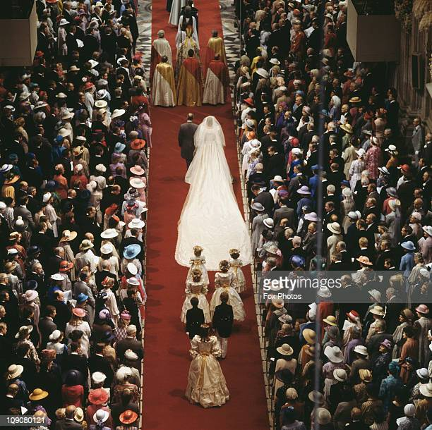 The wedding of Charles Prince of Wales and Lady Diana Spencer in St Paul's Cathedral London 29th July 1981 The bride arrives on the arm of her father...