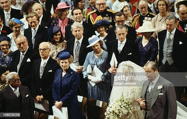 The wedding of Prince Charles and Lady Diana Spencer at St Paul's Cathedral in London 29th July 1981 The bride arrives on the arm of her father John...